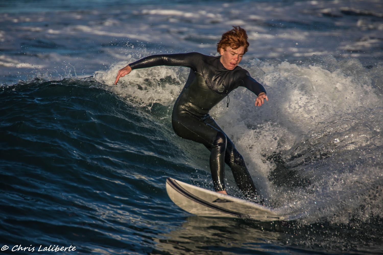 Oceanside Teen surfer by Christopher Laliberte