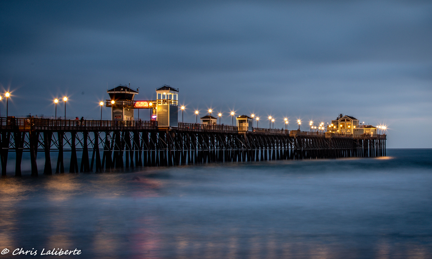Sunset at pier by Christopher Laliberte