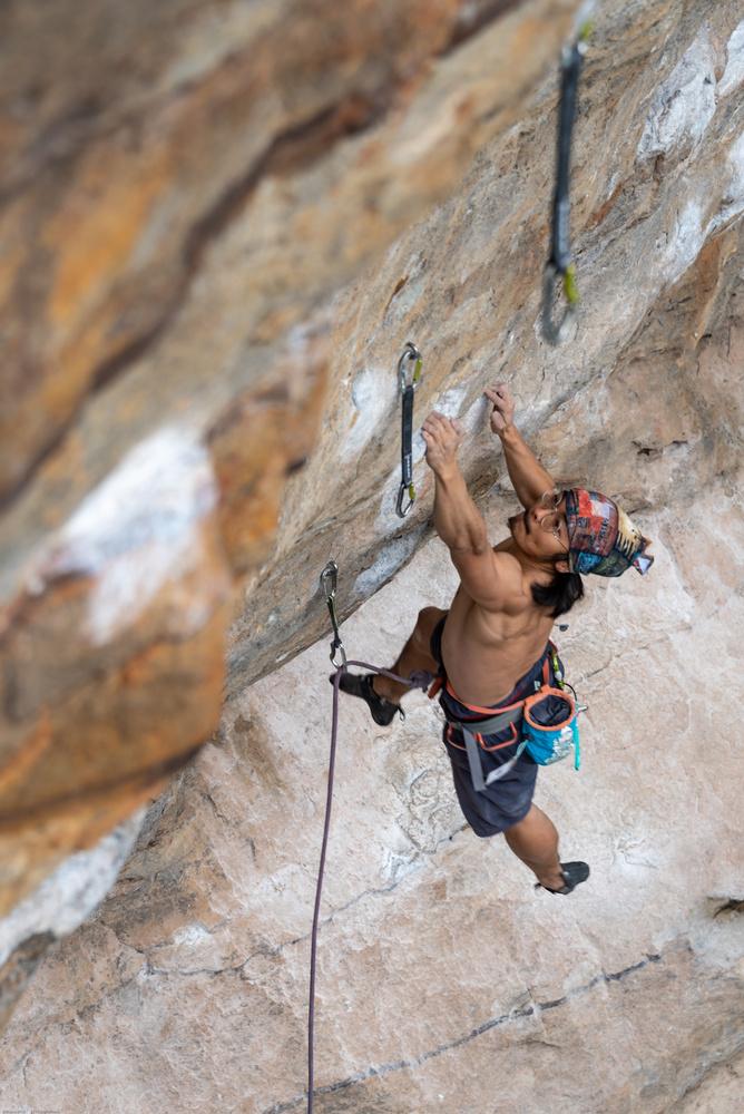 hanging on fingertips by Tim Birkenbach