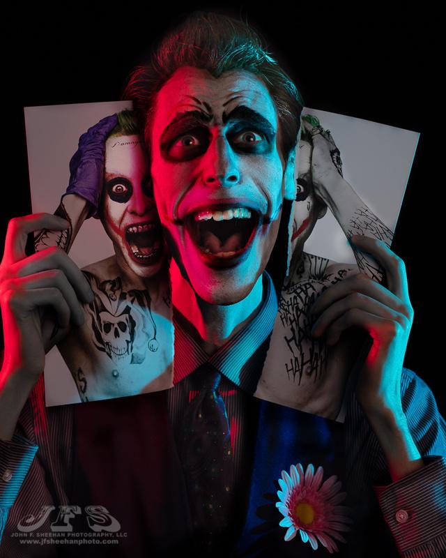 The Joker w/ Ripped Photo  by John Sheehan