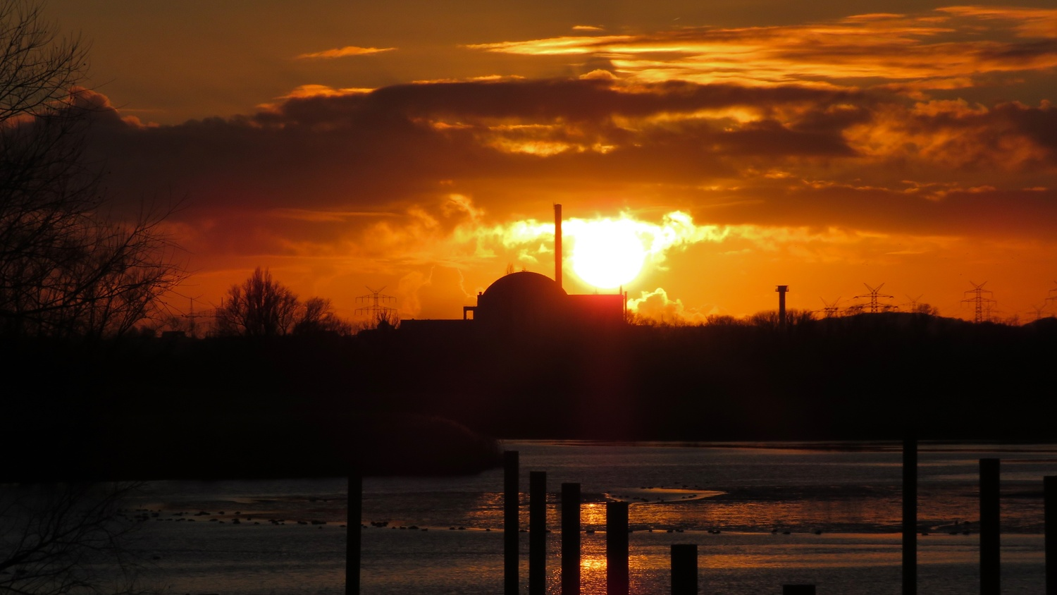 sunset over nuclear power plant by Kandid Letters