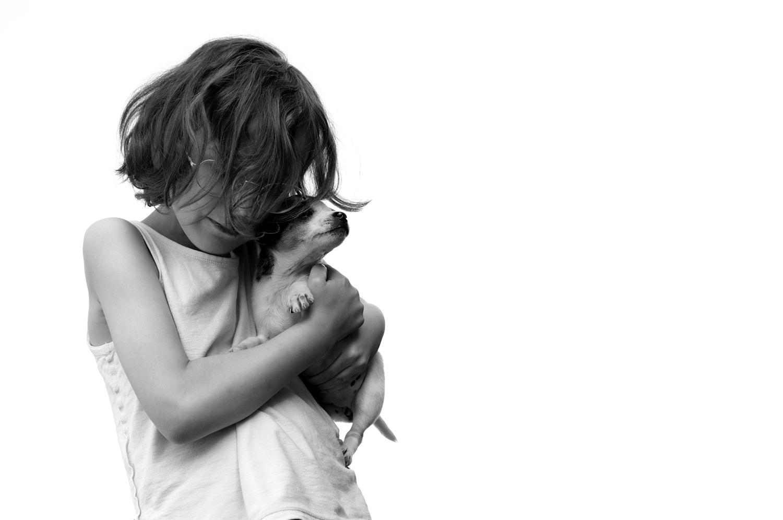 Child and his puppy by Judita Juknelė