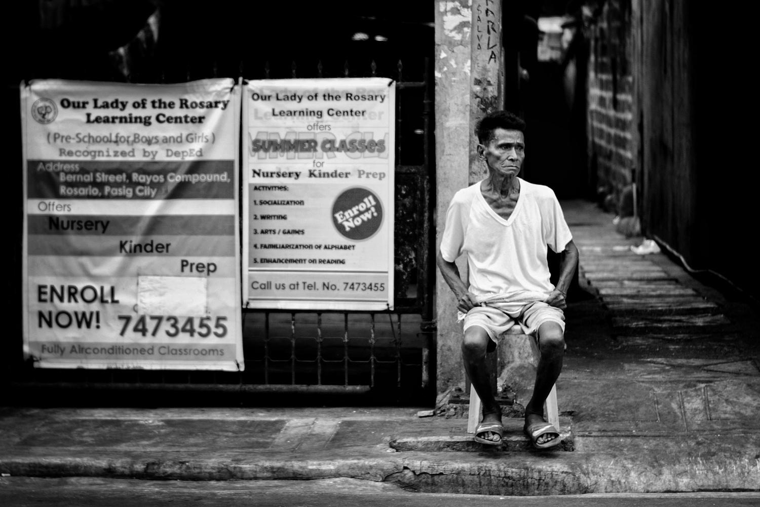 Old man, sitting intently by the street. by Andres Entuna