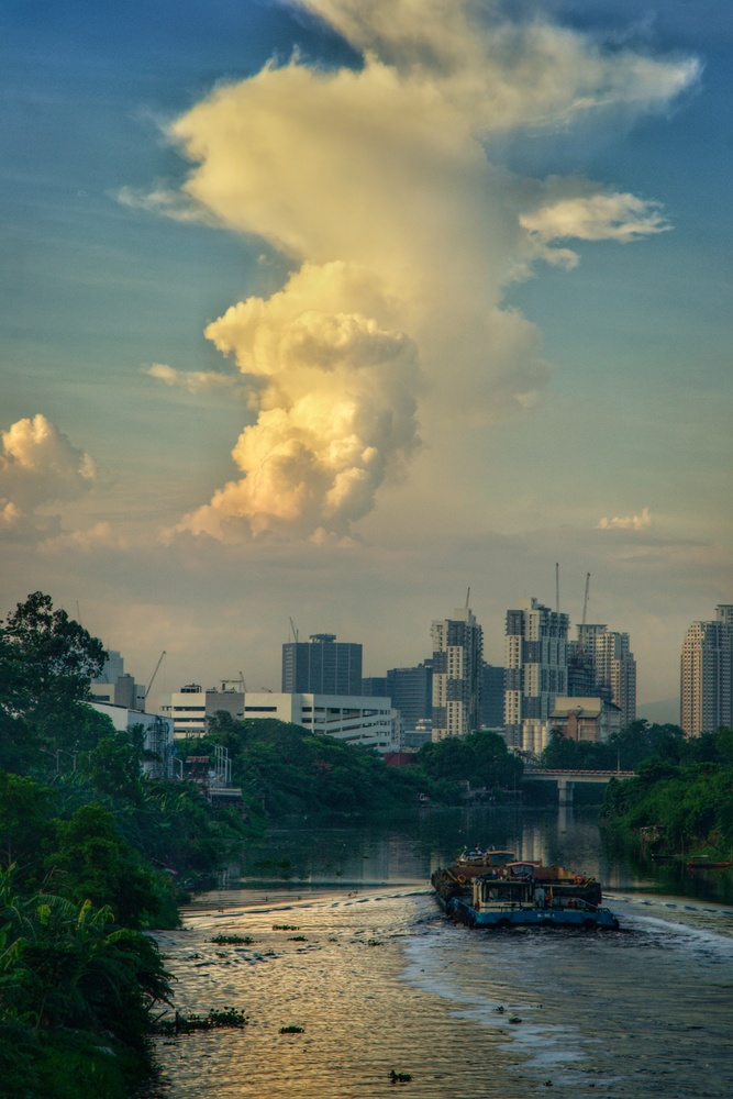 Lovely cloud formation over a river scene. by Andres Entuna