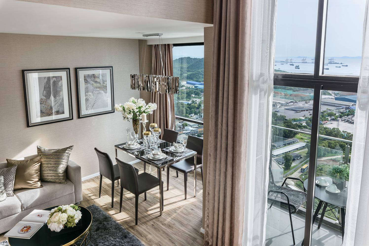 Duplex Unit Dining Area in Condominium. by Adisorn Ruangsiridecha