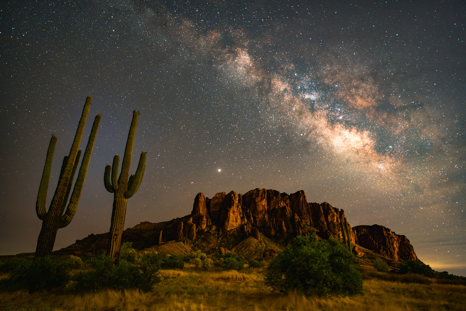 Milky Way & Jupiter Rising Over Superstition Mountain by Jeffrey Moen