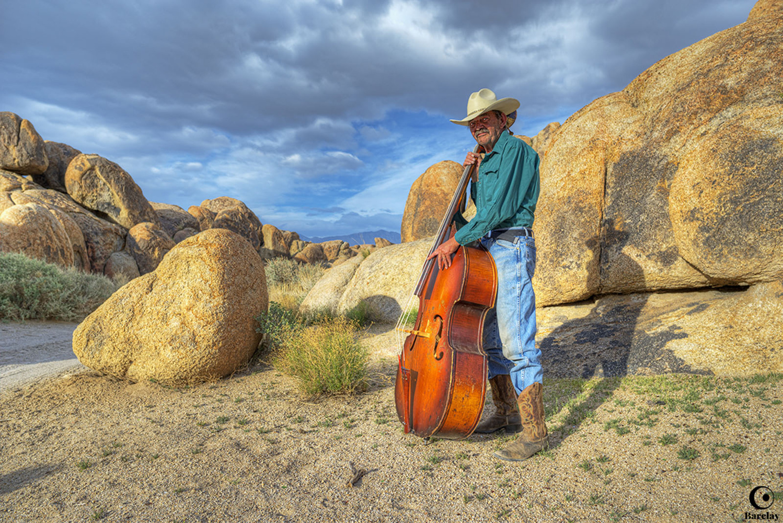 Milton and his Bass Guitar by Glenn Barclay