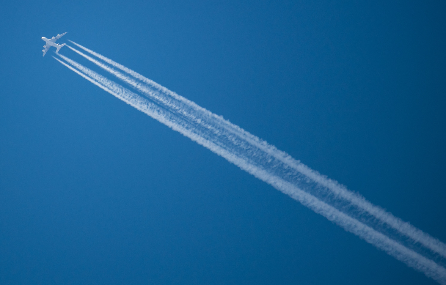 Jet in blue sky by Mike Young