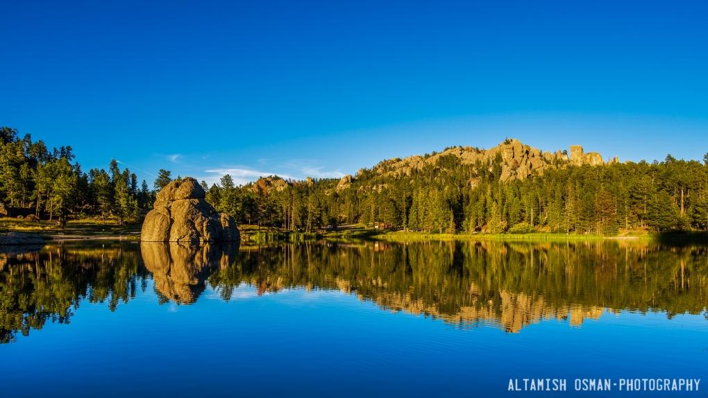 Sylvan Lake Reflection by Altamish Osman