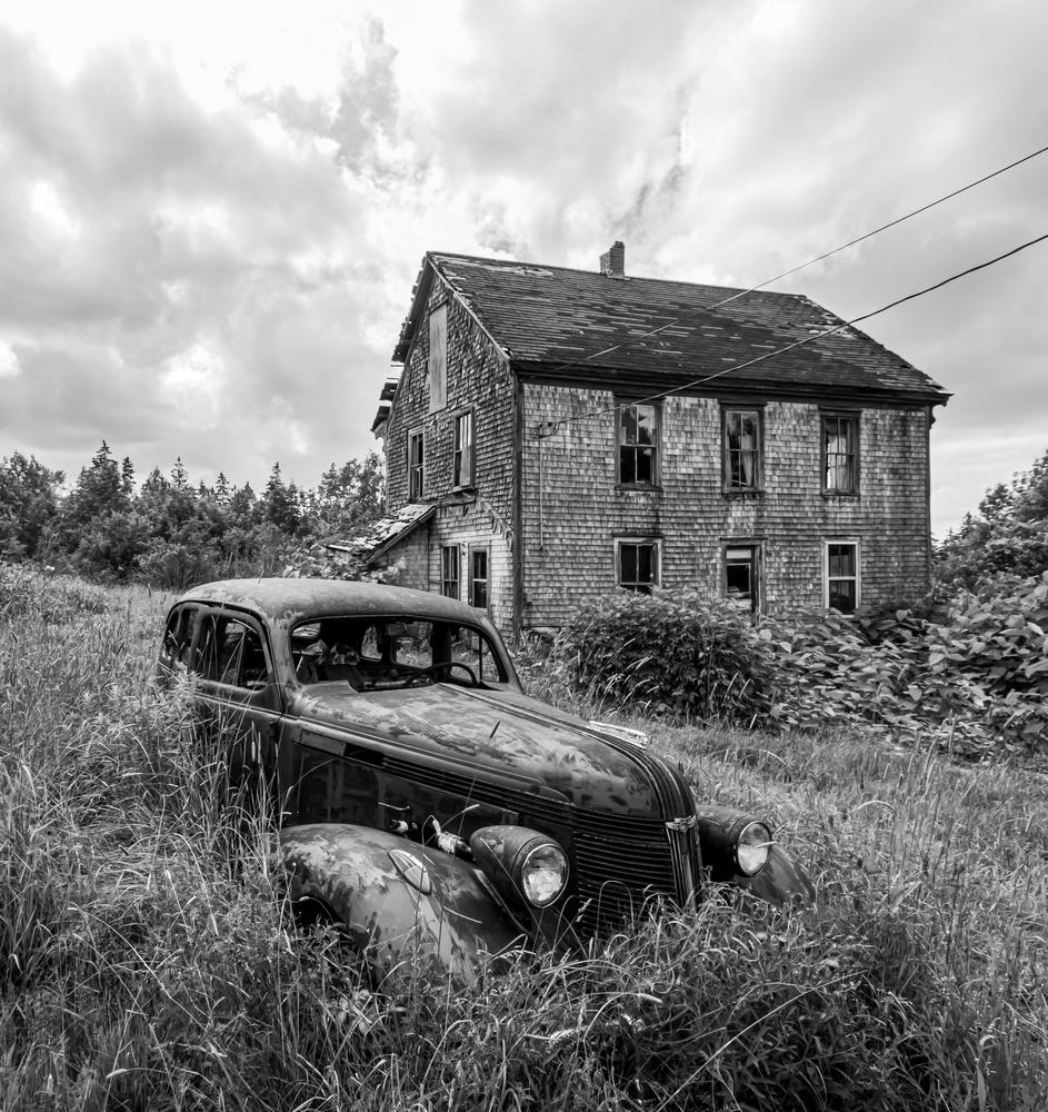 Old Car In Grass by Jason MacIsaac
