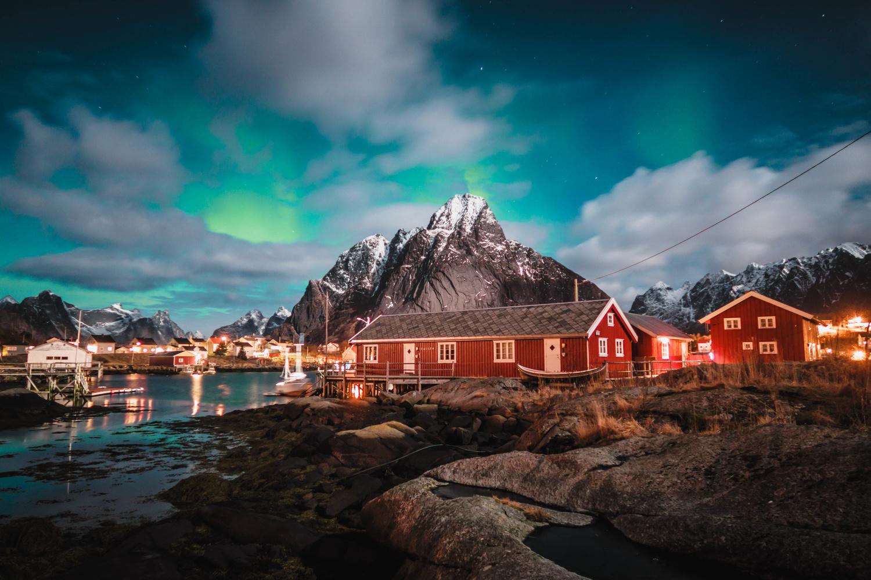 Arctic fishing village aurora by Calum Kozma