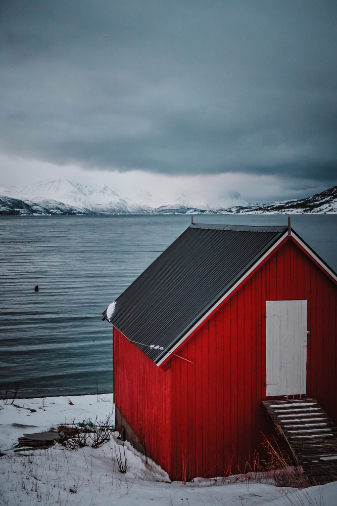 Red cabins of Norway by Calum Kozma