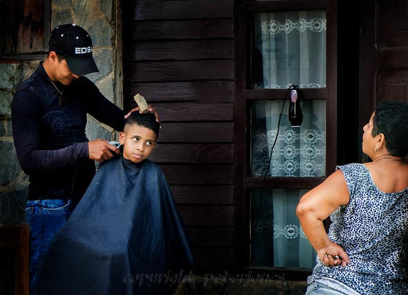 Urban Haircut, Trinidad, Cuba. by Peter Jones