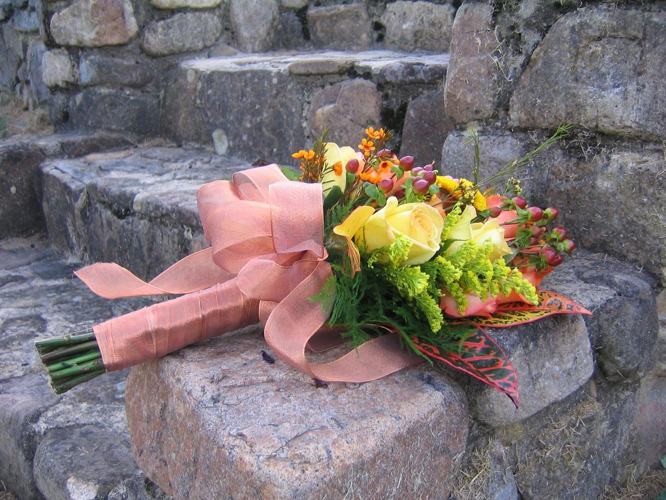 Bouquet on stone steps by Harold Bagel