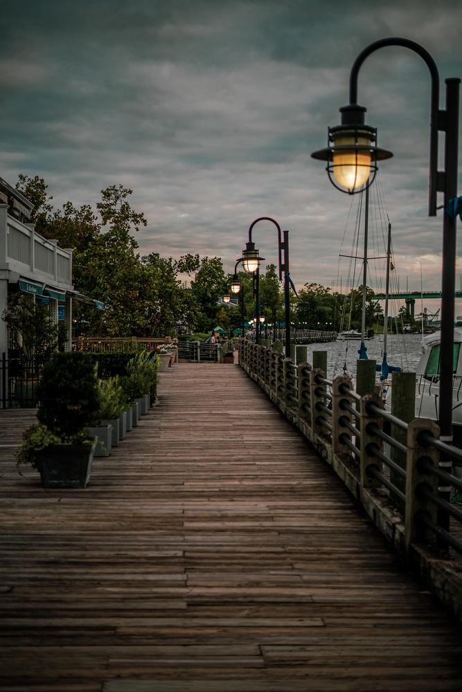 Dusk on the boardwalk. by Caleb Thompson