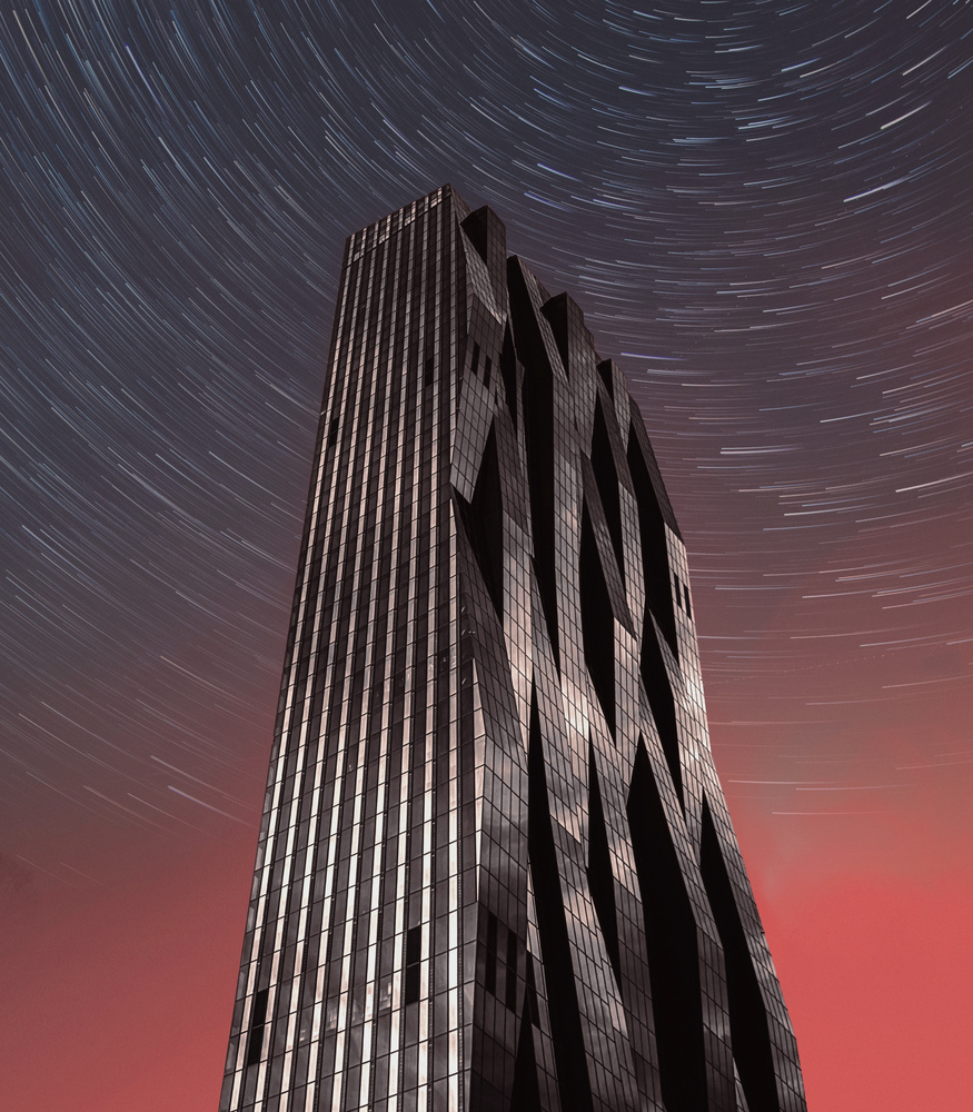 DC tower at night by Mateusz Wesolowski