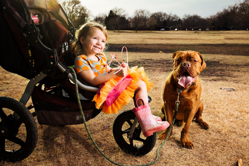 A girl and her dog by David Vaughn