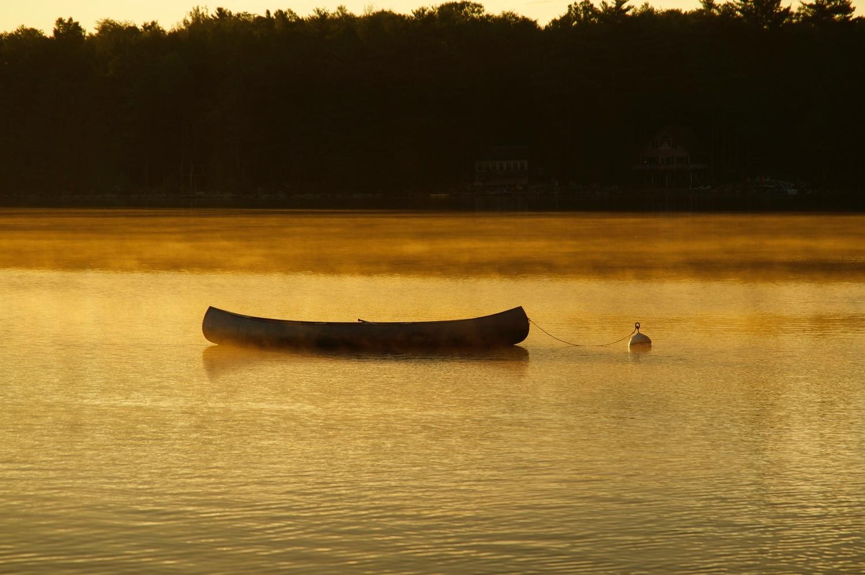 Canoe in morning mist by Eric Kremer