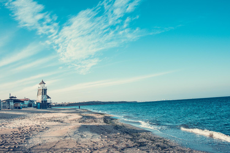 lighthouse on the beach by Madalina Gogoasa