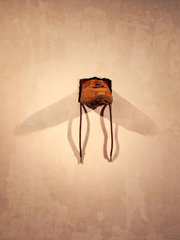 A shoe inside a wall by Yossi Schori