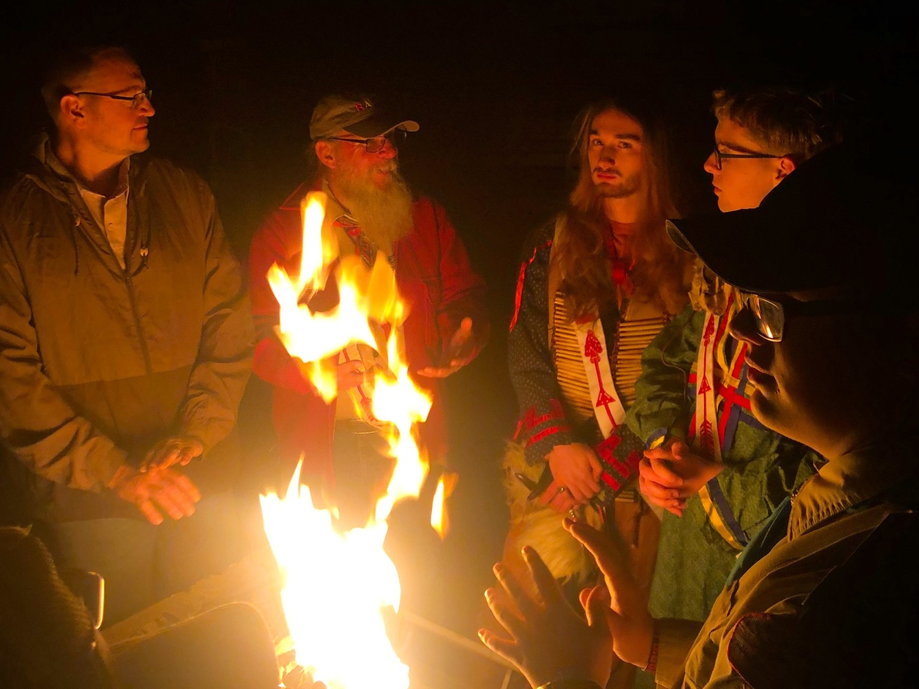 Around the campfire by Jonathan Cole