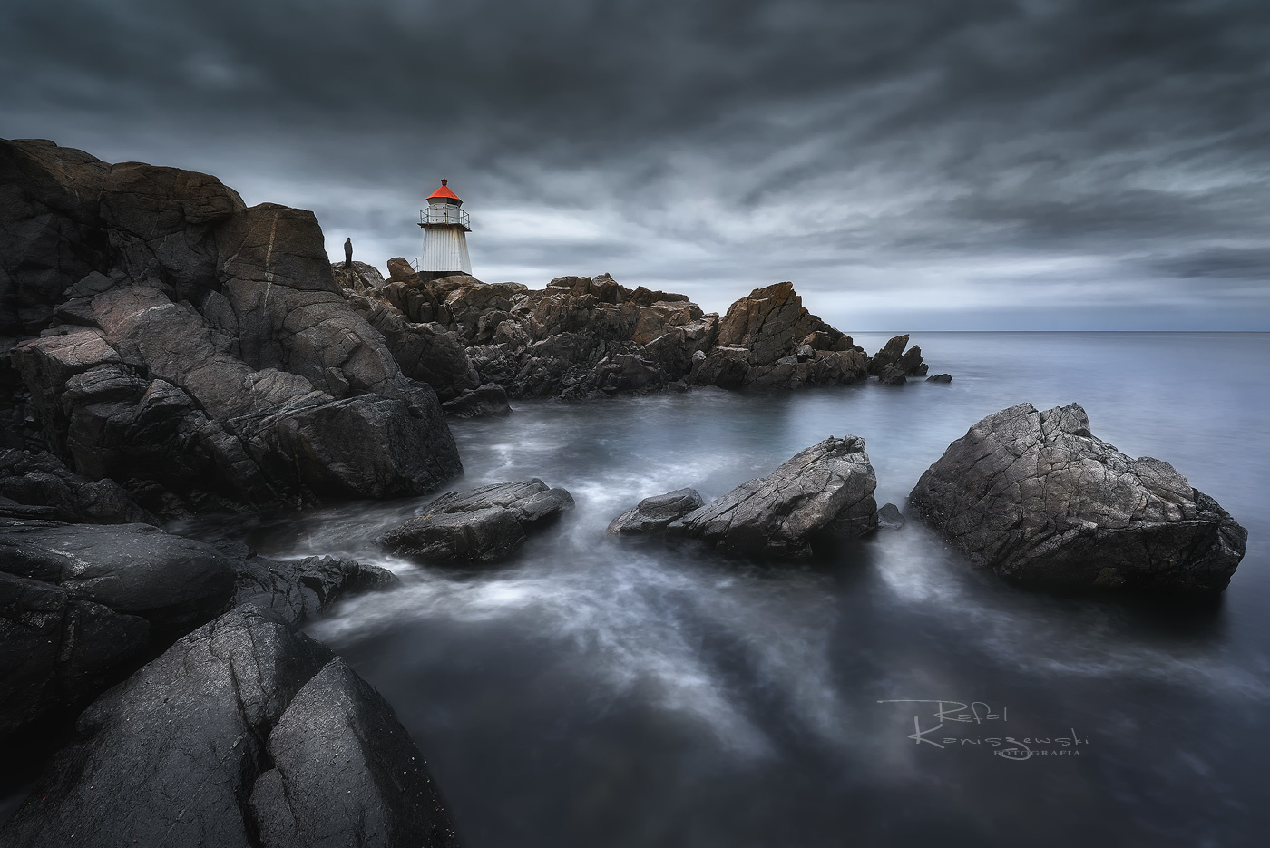 The man and lighthouse by Rafal Kani