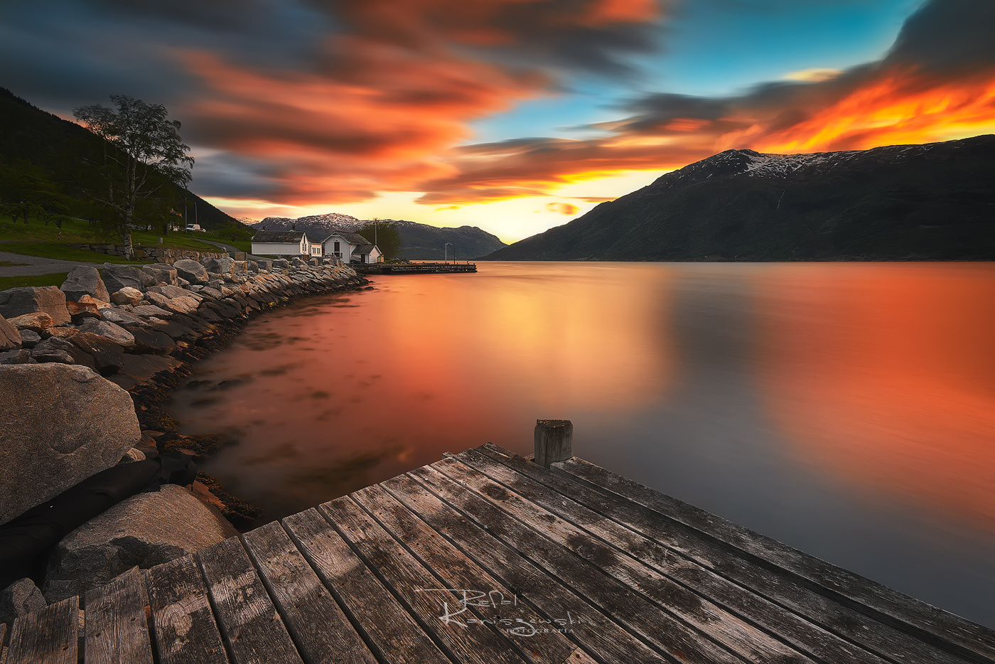 Sunset over the fjord by Rafal Kani