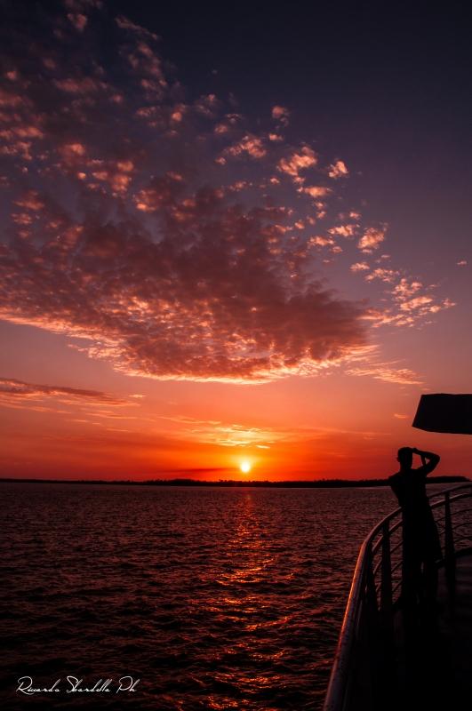 Sunset on a photographer by Riccardo Sbardella