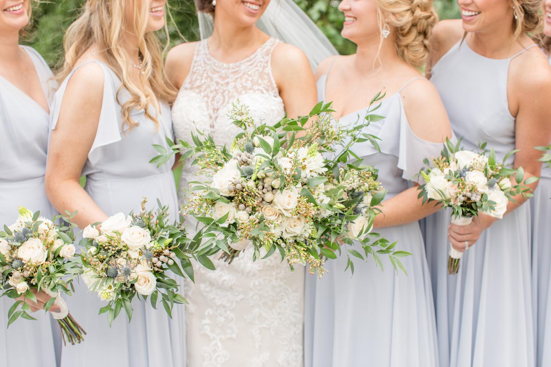 Bride & bridesmaids with lush wedding bouquets by Katie Dixon
