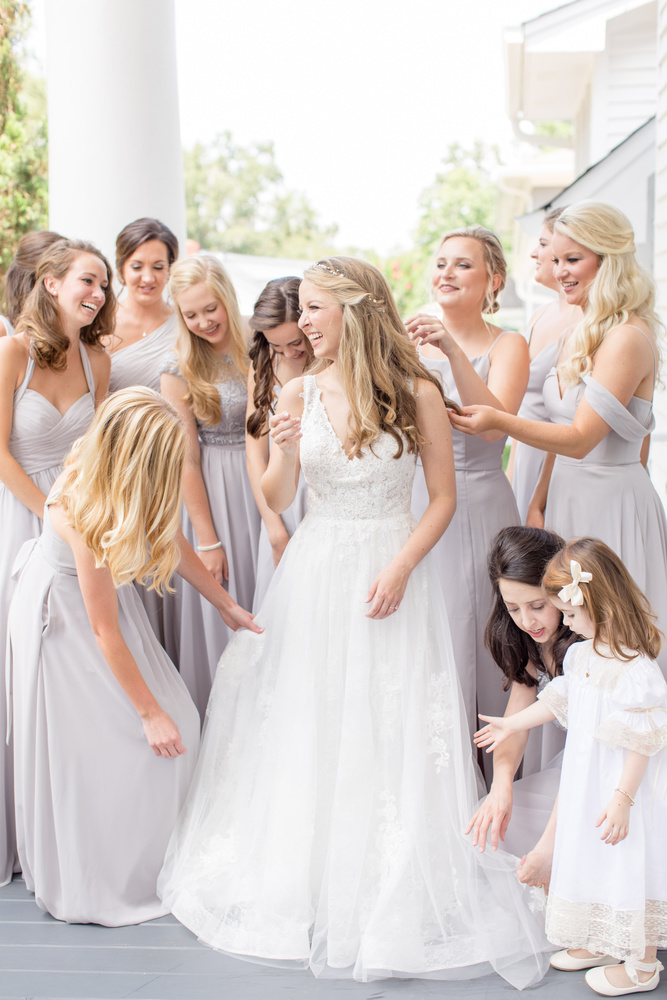 Bride getting ready with her bridesmaids by Katie Dixon