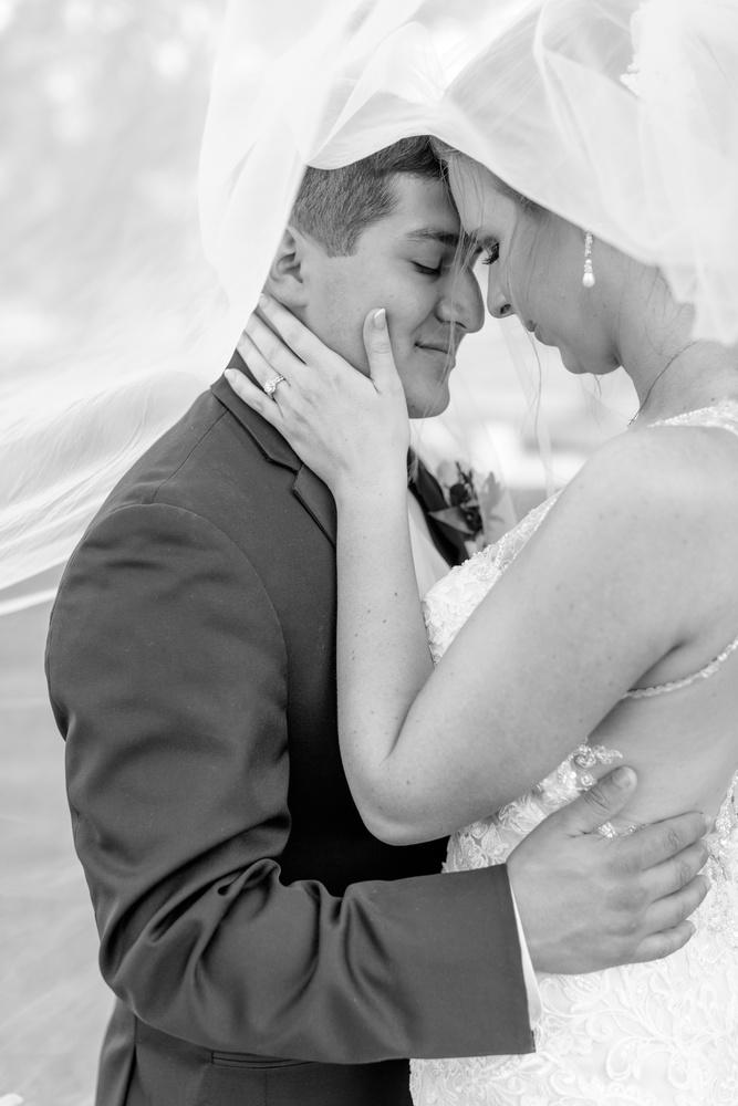 Bride & groom hidden under her veil by Katie Dixon