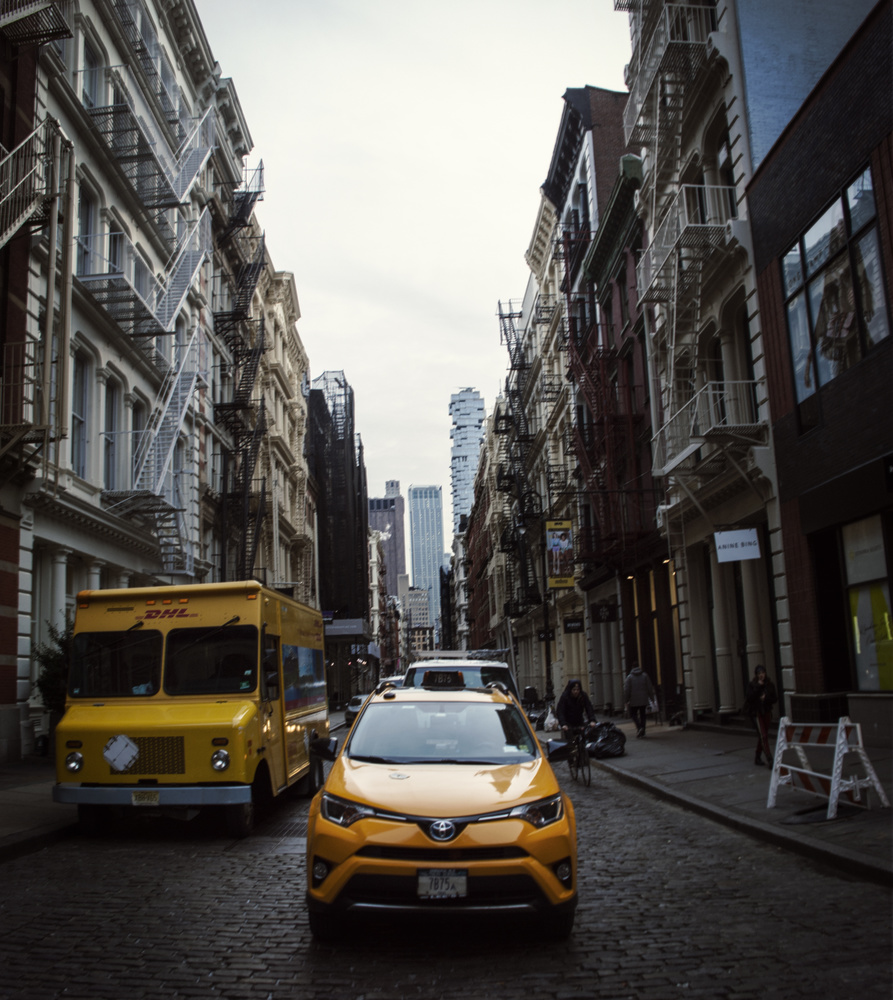 Yellow in the street by Adrian Lopez