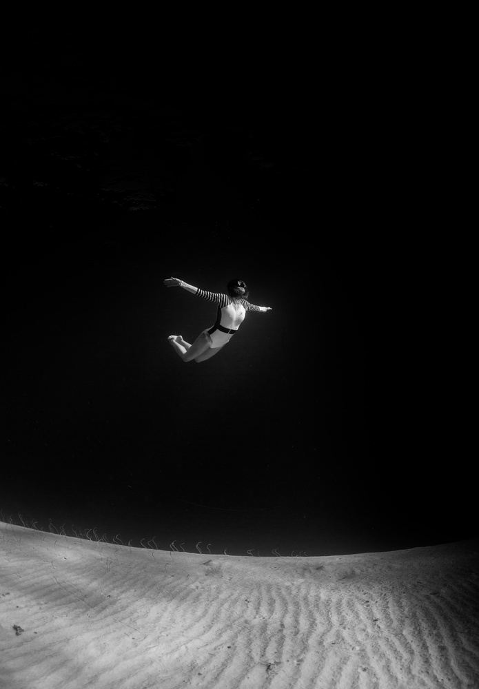 Skydiving in the dark by Livio Fakeye