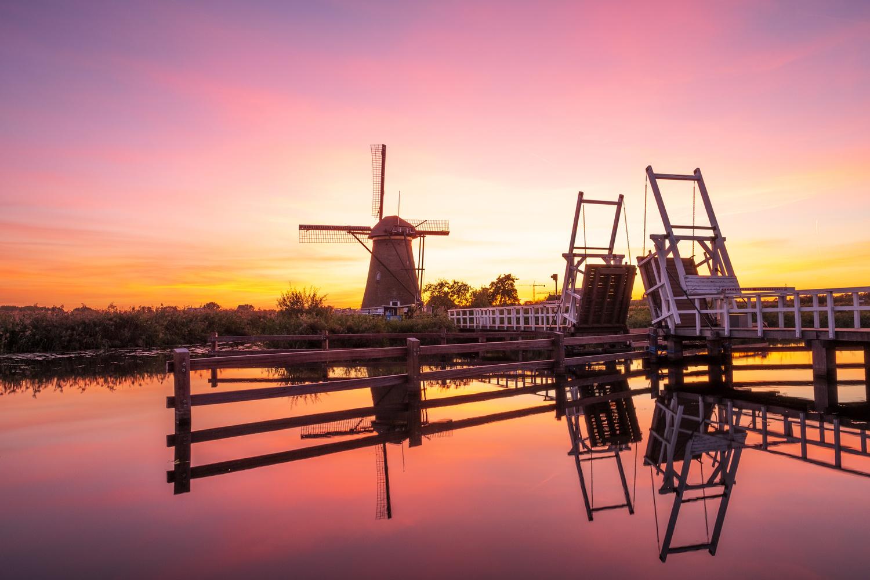 Pink sunset at Kinderdijk the Netherlands by Erik Graumans