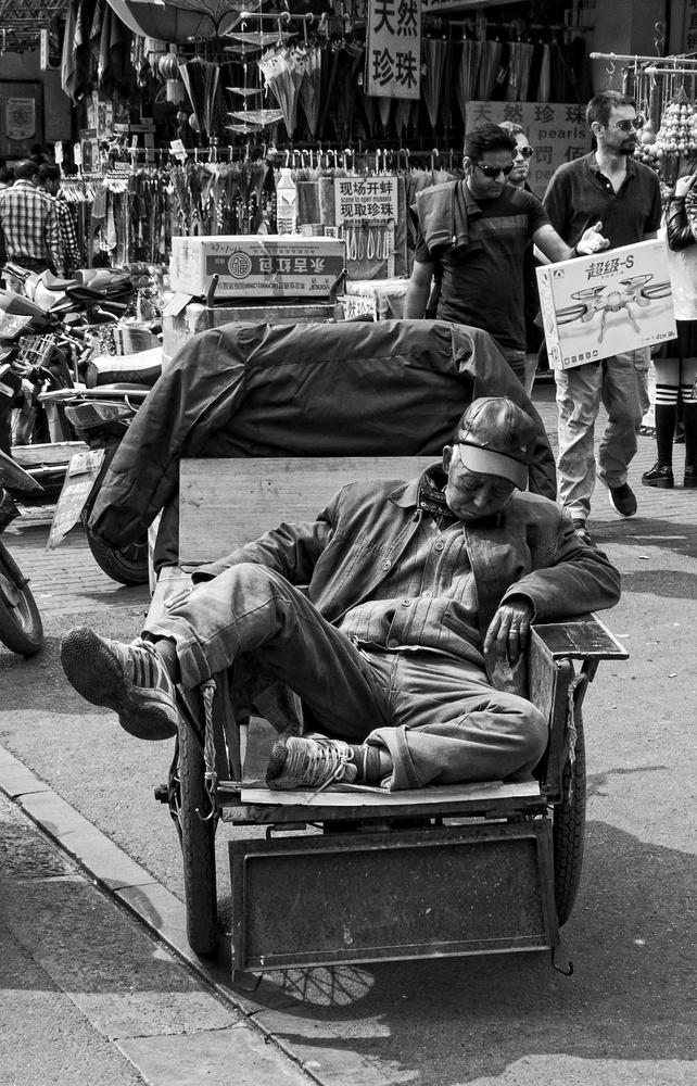 Chinese sleeping man by Chris Mummery