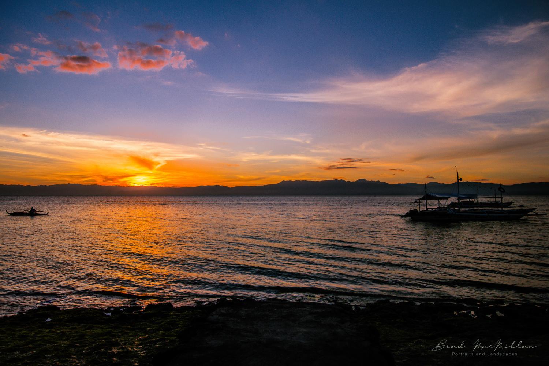 Moalboal Sunset by Brad MacMillan