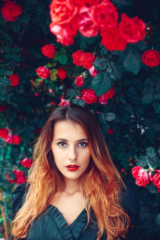 portrait of girl in roses by Oleg Nagel