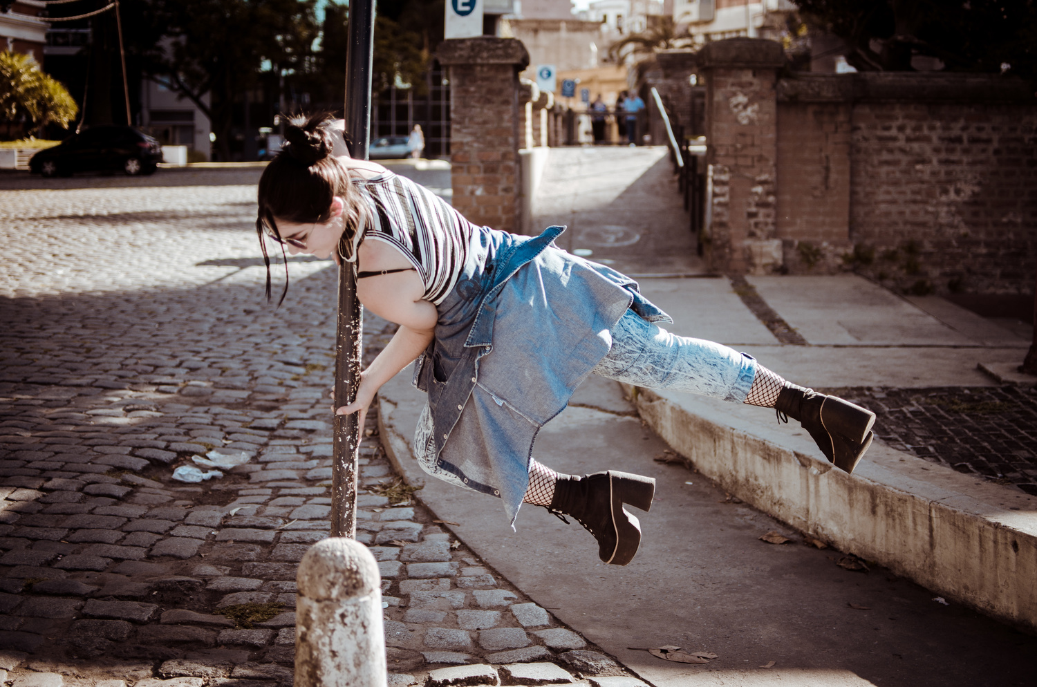 Poledancing in the streets by Cristian Corvalan