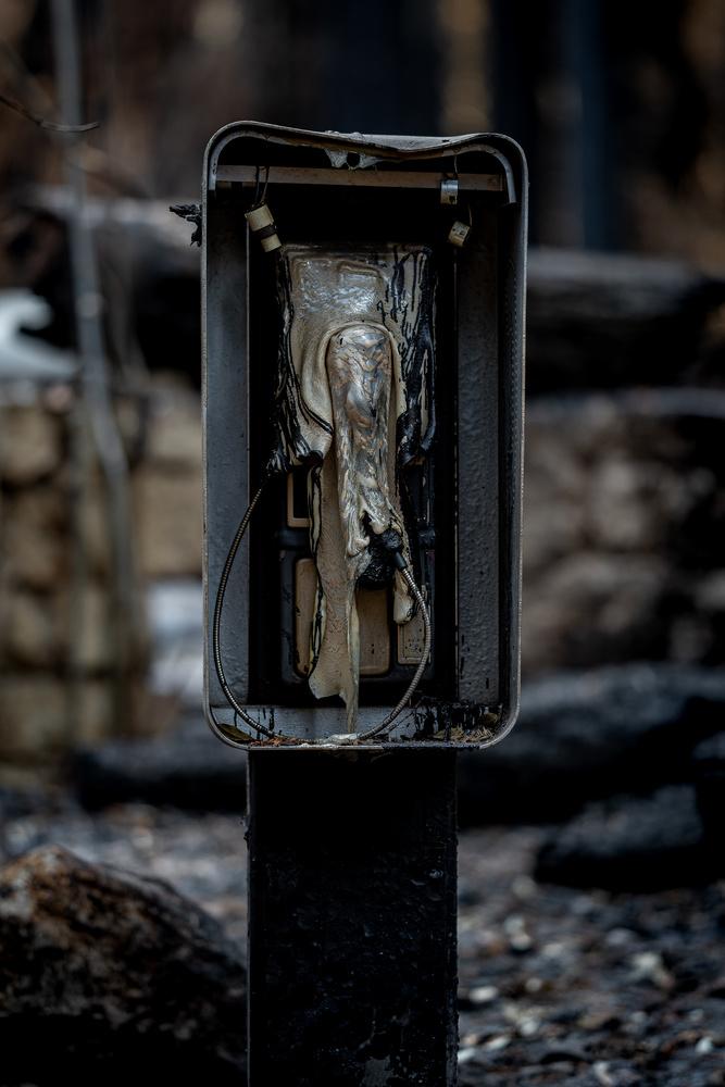 Fire Meets Payphone by Daniel Mekis