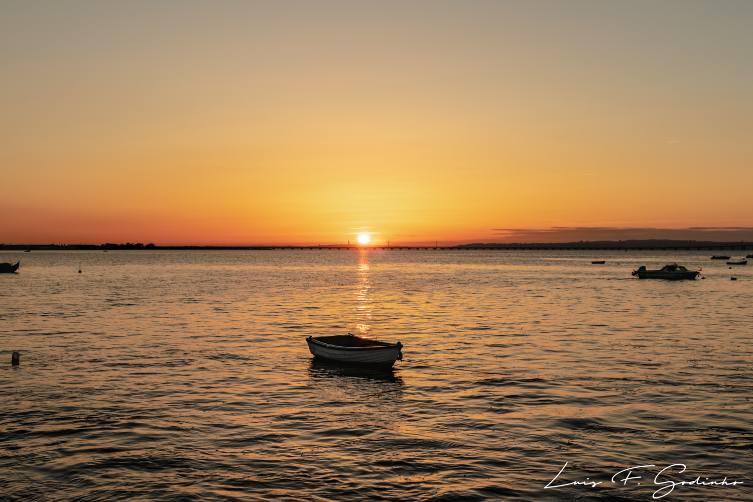 sunset on the river with boats by Luis F Godinho