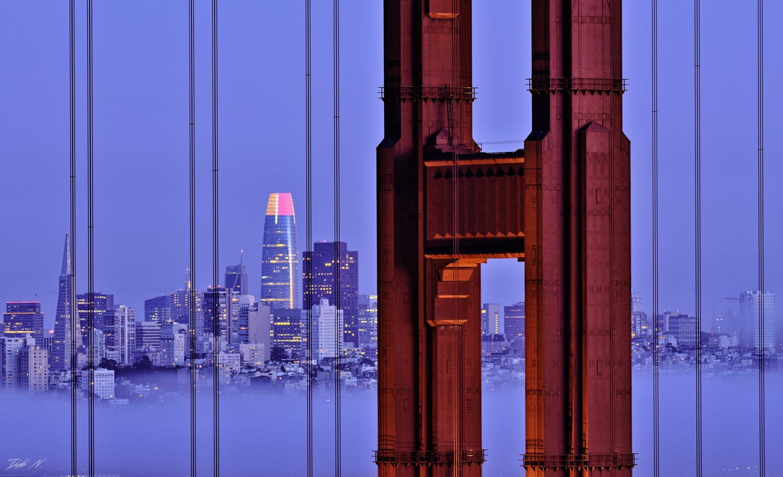 Foggy San Francisco skyline from behind the Golden Gate Bridge. by Dubi N.