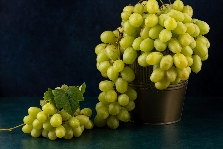 Green grapes by Skyler Ewing
