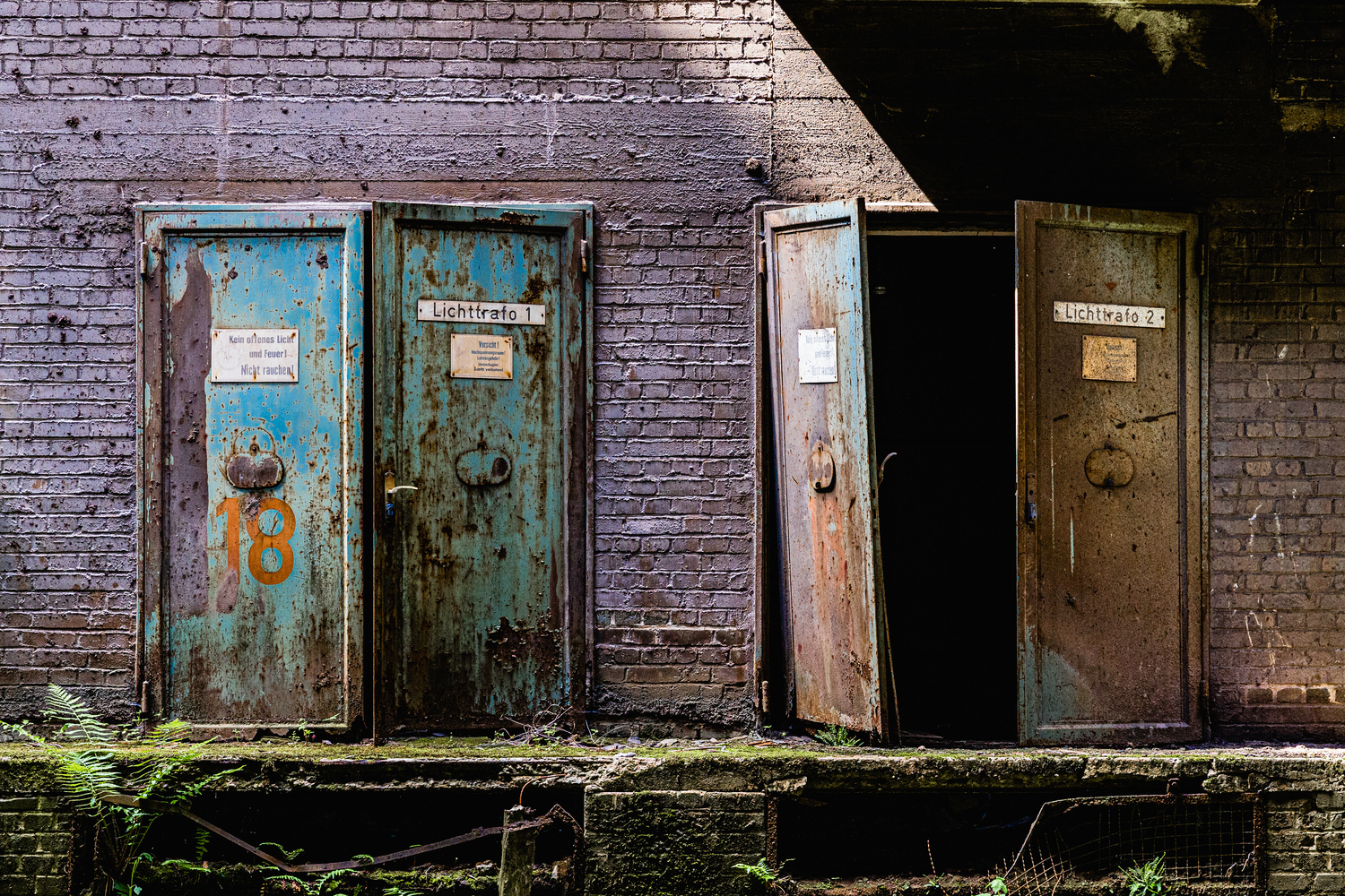 Old steel doors in an abandoned factory by Vik Fuchs