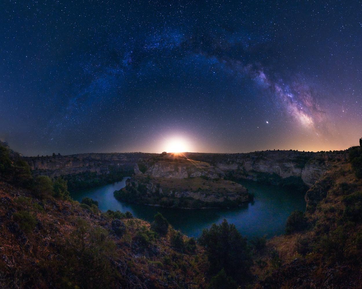 Moon rising under Milky Way arc by Prince Berkoh