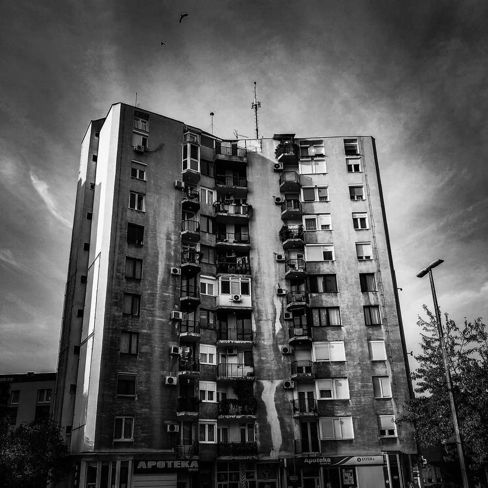 White skyscraper by Goran Avramovic
