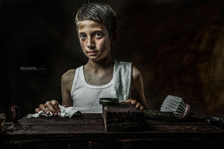 The shoeshine boy by Akis Douzlatzis