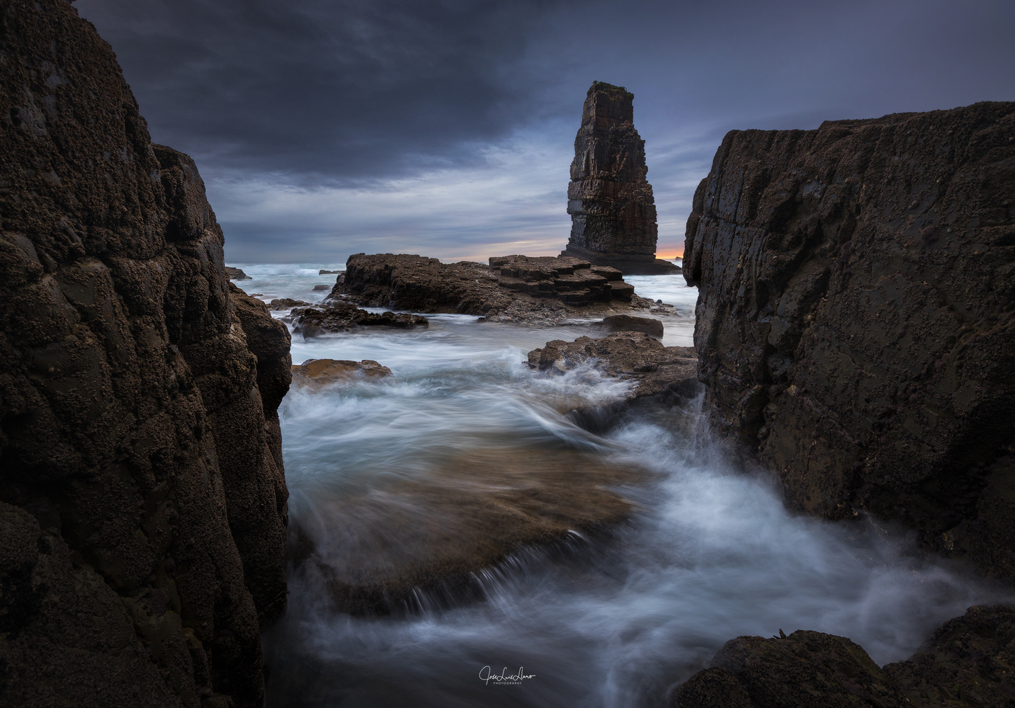 Between rocks by Jose Luis Llano