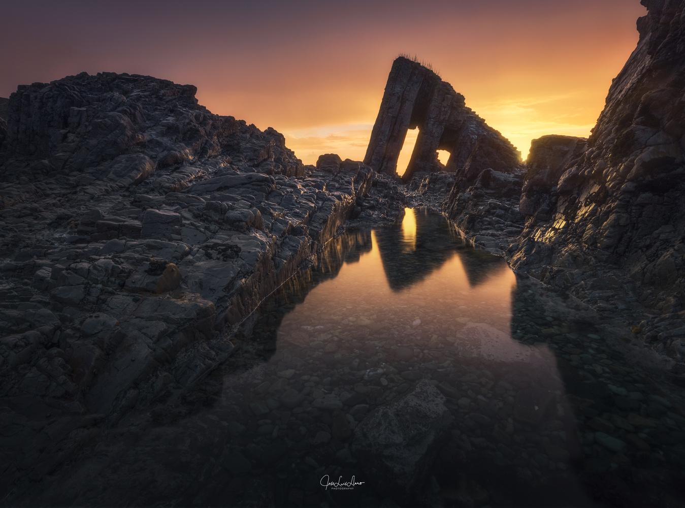 Sunset on the Vallina beach by Jose Luis Llano