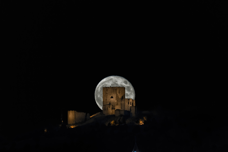 The full moon behind the Teba Castle by DaniGviews /Daniel