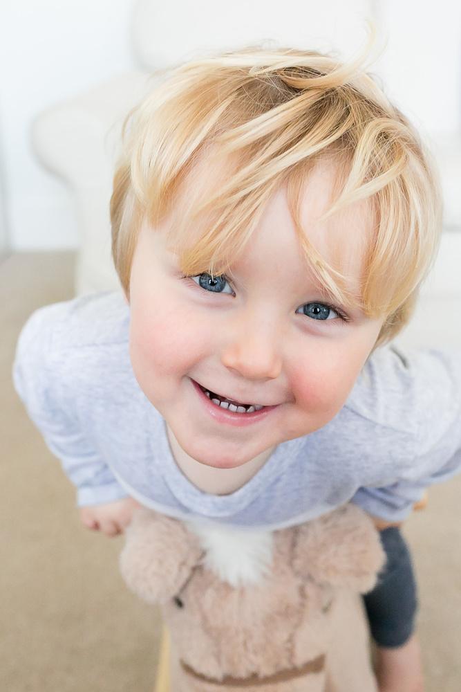 Grinning toddler by Louise Downham